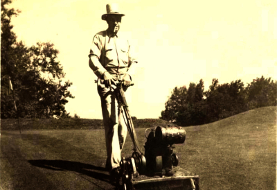 An old photograph of a man tending to the greens at the course at Pehquenakonck Country Club
